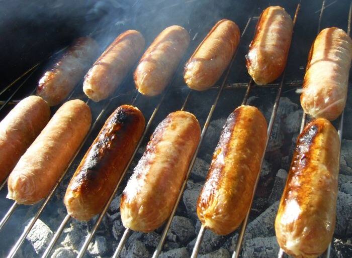 Carry On Camping With Kids - Cooking Sausages On An Open Fire